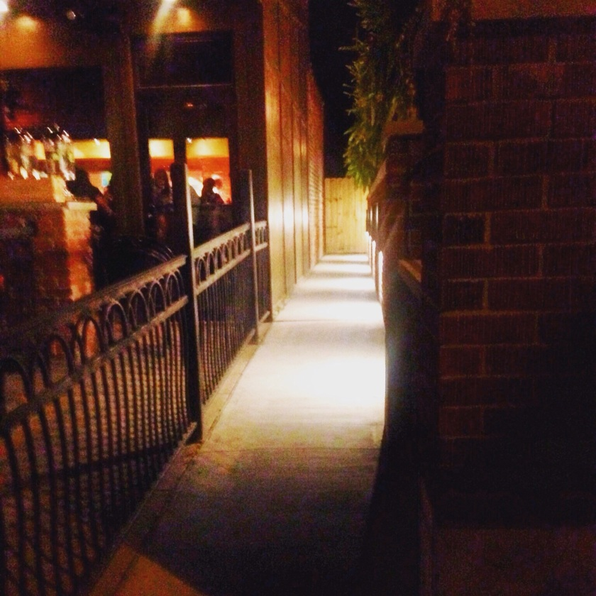 "Barrio's dog ""VIP"" entrance next to Press Wine Bar."